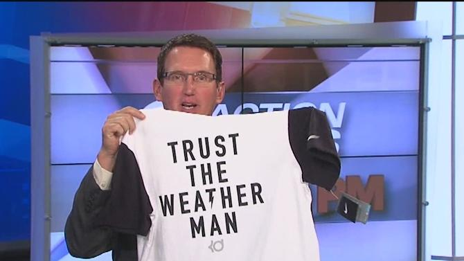 Trust the Weather Man: Dave Rexroth gets t-shirt gift on set during newscast