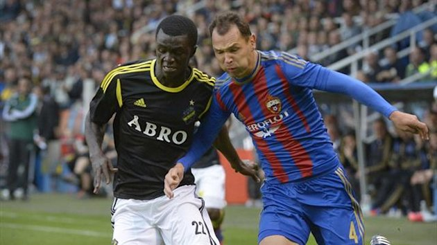 AIK's Kwame Karikari fights for the ball with CSKA Moscow's Sergei Ignashevich (Reuters)
