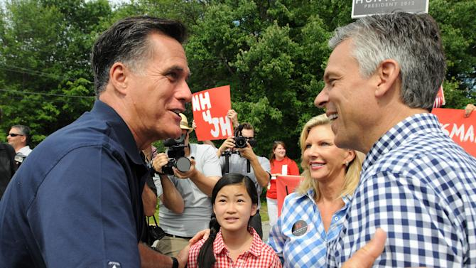 Republican Presidential Candidates Romney and Huntsman Campaign In New Hampshire On July 4th