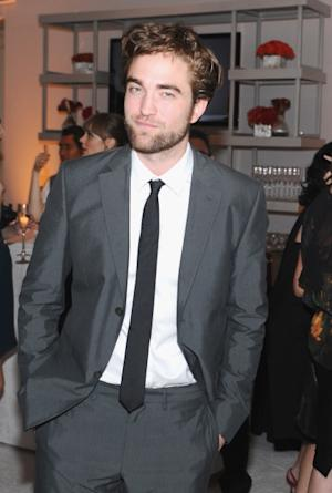 Robert Pattinson is all smiles at ELLE's 19th Annual Women In Hollywood Celebration at the Four Seasons Hotel in Beverly Hills, Calif. on October 15, 2012 -- Getty Premium