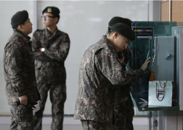 South Korean soldiers use public phones after a report about a possible nuclear test conducted by North Korea, at the Seoul train station in Seoul, South Korea, Tuesday, Feb. 12, 2013. North Korea app