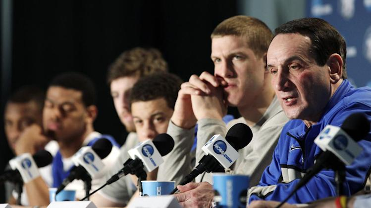 Duke head coach Mike Krzyzewski talks to reporters during a news conference, Saturday, March 30, 2013, in Indianapolis. Duke is scheduled to play Louisville in the Midwest Regional final in the NCAA college basketball tournament on Sunday. (AP Photo/Kiichiro Sato)