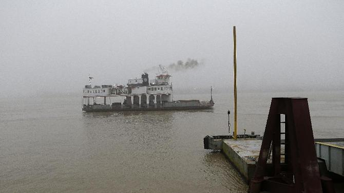 This Jan. 15, 2013 photo shows a ferry boat crossing the Mississippi River from Downtown to Algiers in New Orleans. A boat ride is one of the best ways to get a look at the New Orleans skyline and the Mississippi River's daily parade of river barges, steamships and cruise ships. The Algiers Point ferry, which has been in operation since the early 1800s, is free to pedestrians. (AP Photo/Gerald Herbert)