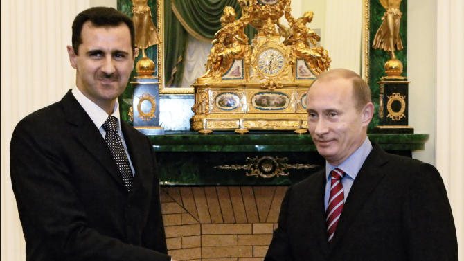 FILE -  In this Tuesday, Dec. 19, 2006 file photo Vladimir Putin, then Russian President, right, and his Syrian counterpart Bashar Assad smile as they shake hands in Moscow's Kremlin. With even his most powerful ally, Russia, losing faith in him, President Bashar Assad may appear to be heading for a last stand against rebel forces who have been waging a ferocious battle to overthrow him for nearly two years. But Assad still has thousands of elite and loyal troops behind him, and analysts say that even if he wanted to give up the fight, it's unclear those around him would let him abandon ship and leave them to an uncertain fate.(AP photo/RIA Novosti, Mikhail Klimentyev, Presidential Press service, File)