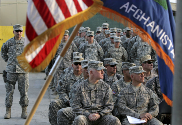 FILE - In this  Sept 11, 2008 file photograph, US soldiers attend a ceremony marking the 7th anniversary of the Sept. 11 attacks, at the U.S Camp Phoenix in Kabul, Afghanistan. .U.S. military deaths i