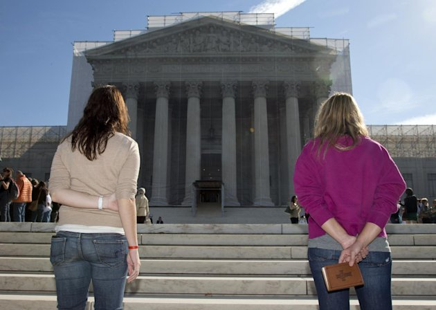 Women pray on the front steps of the Supreme Court in Washington, Monday, Oct. 1, 2012. The Supreme Court is embarking on a new term that could be as consequential as the last one with the prospect for major rulings about affirmative action, gay marriage and voting rights. (AP Photo/Carolyn Kaster)