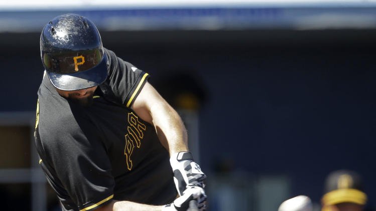 Pittsburgh Pirates catcher Tony Sanchez hits and RBI double in the first inning of a exhibition baseball game against the Tampa Bay Rays in Port Charlotte, Fla., Saturday, March 8, 2014. The Pirates won 10-5. (AP Photo/Gerald Herbert)