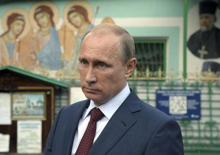 Russia's President Putin leaves the Life-giving Trinity church in Moscow