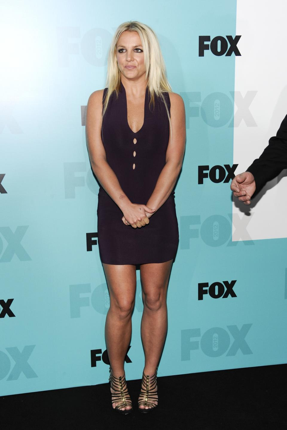 "New ""X Factor"" judge Britney Spears attends the FOX network upfront presentation party at Wollman Rink, Monday, May 14, 2012 in New York. (AP Photo/Evan Agostini)"