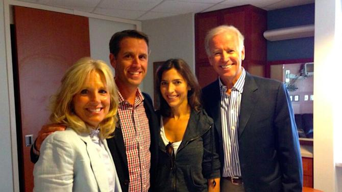 In this photo posted to the Twitter account of the Office of Delaware Attorney General Beau Biden, Biden, second left, poses for a photo with, from left, his mother, Dr. Jill Biden; his wife, Hallie Biden; and his father, Vice President Joe Biden, Thursday, Aug. 22, 2013, in Houston. Beau Biden returned home Thursday after undergoing a medical procedure at a Houston cancer center. (AP Photo/Beau Biden Twitter)