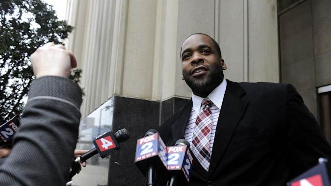 Former Detroit Mayor Kwame Kilpatrick leaves federal court after being convicted Monday, March 11, 2013, in Detroit, of corruption charges, ensuring a return to prison for a man once among the nation's youngest big-city leaders. (AP Photo/Detroit News, David Coates)