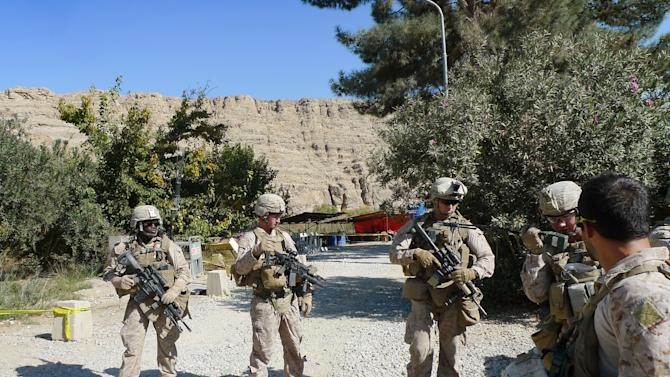 In this Thursday, Nov. 15, 2012 photo, U.S. Marines provide escort at the Kajaki dam in Helmand province, south of Kabul, Afghanistan. Helmand province, home of the Kajaki dam, is seeing the first and largest wave of U.S. troop reductions, with 10,000 of 17,000 U.S. Marines already gone. That means most of the Kajaki project is going forward with Afghan forces providing nearly all the security in an area that was a Taliban stronghold until a year ago. (AP Photo/Heidi Vogt)