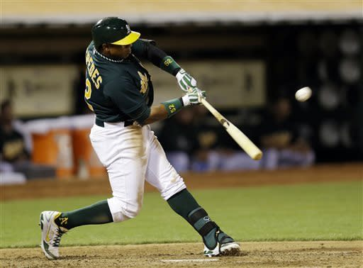 Cespedes drives in 4 runs, A's beat Angels 10-6