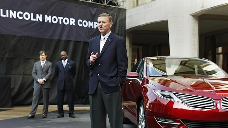 Mulally, president and CEO of Ford Motor Company, speaks next to Lincoln MKZ mid-size sedan during news conference in New York