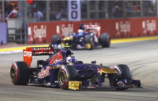 Toro Rosso Formula One driver Ricciardo leads team mate Vergne during the Singapore F1 Grand Prix in Singapore