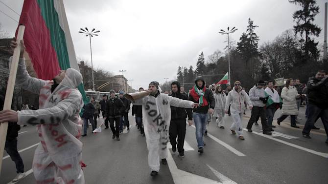 "Bulgarians shout slogans as they block the traffic at main road juncture during a protest against higher electricity and heating bills, in Sofia,  Sunday, Feb. 17, 2013. Thousands of angry Bulgarians chanted ""mafia"" and ""resignation""  demanded the expulsion of the three foreign-controlled power distributors that control the local market: Czech Republic's CEZ and Energo-Pro, and Austria's EVN   (AP Photo/Valentina Petrova)"