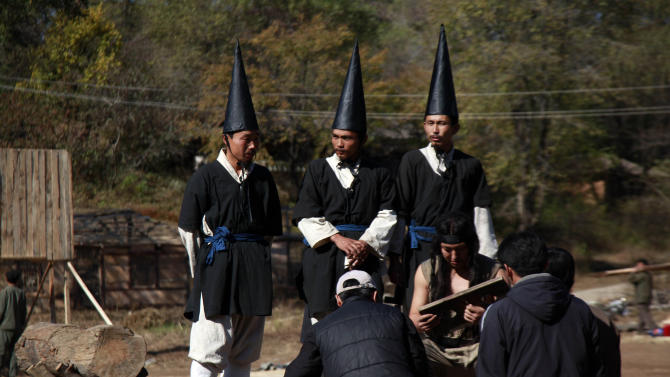 In this photo taken Tuesday, Oct. 25, 2011, performers wait to film a show at a period film set in Pyongyang, North Korea. An international film festival opens Thursday, Sept. 20 in the unlikeliest of places: North Korea. Held every two years, the Pyongyang International Film Festival is the only time North Koreans get to see a wide array of foreign films on the big screen. It's also the only time foreigners are allowed into North Korean movie theaters to see films alongside the locals. (AP Photo/Ng Han Guan)