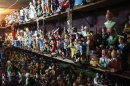 """Shelves crammed with figurines from """"Tintin"""" are displayed at the workshop of Congolese artist Kakese in Kinshasa"""