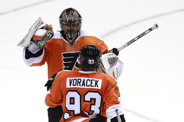Philadelphia Flyers' Bryzgalov and Voracek celebrate their win over Winnipeg Jets in their NHL ice hockey game in Philadelphia