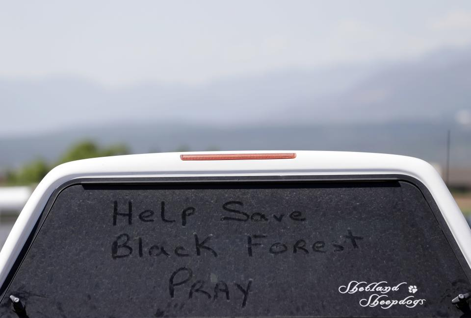 "A note written on a vehicle's dusty window reads, ""Help Save Black Forest. Pray"" at a Red Cross shelter for evacuees of the Black Forest Fire at Palmer Ridge High School in Monument, Colo. on Saturday, June 15, 2013. (AP Photo/Marcio Jose Sanchez)"