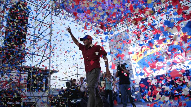 Opposition's presidential candidate Henrique Capriles waves to supporters during a campaign rally in Barinas, Venezuela, Monday, Sept. 24, 2012. Capriles is running against President Hugo Chavez in the country's Oct. 7 election. (AP Photo/Ariana Cubillos)