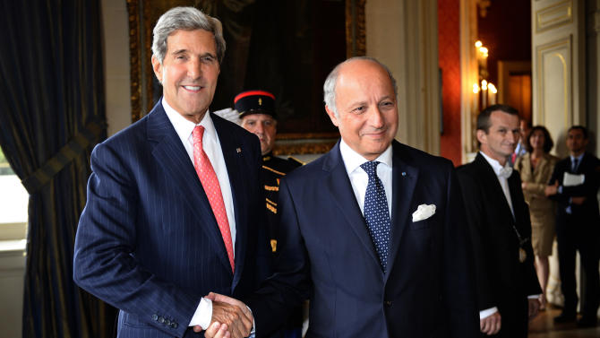 French Foreign Affairs Minister Laurent Fabius, center shakes hands with US Secretary of State John Kerry at the ministry in Paris, on Saturday Sept.7, 2013. Kerry traveled to Europe to court international support for a possible strike on the Syrian regime for its alleged use of chemical weapons while making calls back home to lobby Congress where the action faces an uphill battle.(AP Photo/Lionel Bonaventure/Pool)