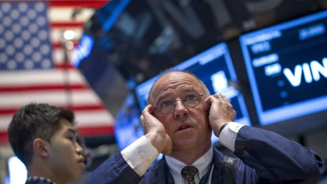 JPMorgan Chase trader Frederick Reimer works on the floor of the New York Stock Exchange