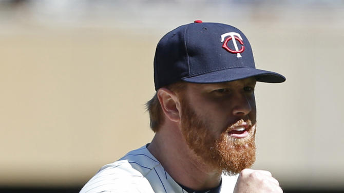 Minnesota Twins pitcher Blaine Boyer celebrates the final out and his save as the Twins beat the Toronto Blue Jays 3-2 in a baseball game, Saturday, May 30, 2015, in Minneapolis. (AP Photo/Jim Mone)