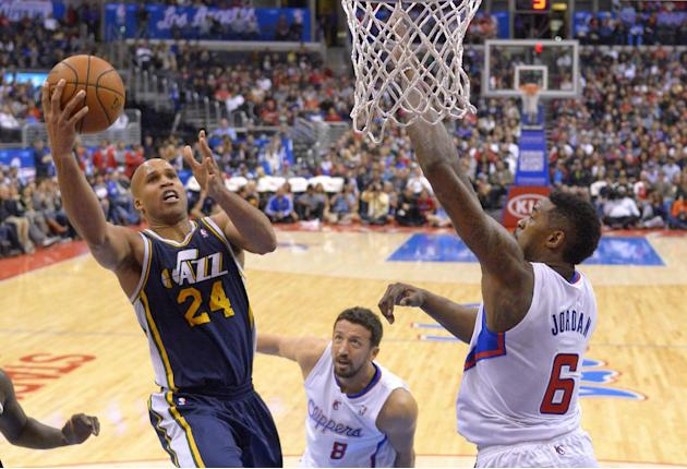 Utah Jazz forward Richard Jefferson, left, puts up a shot as Los Angeles Clippers center DeAndre Jordan, right, defends and forward Hedo Turkoglu, of Turkey, looks on during the second half of an NBA