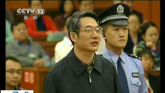 Still image taken from video shows former deputy head of China's top planning agency, The National Development and Reform Commission, Liu speaking during his trial at Intermediate People's Court in Langfang, Hebei province