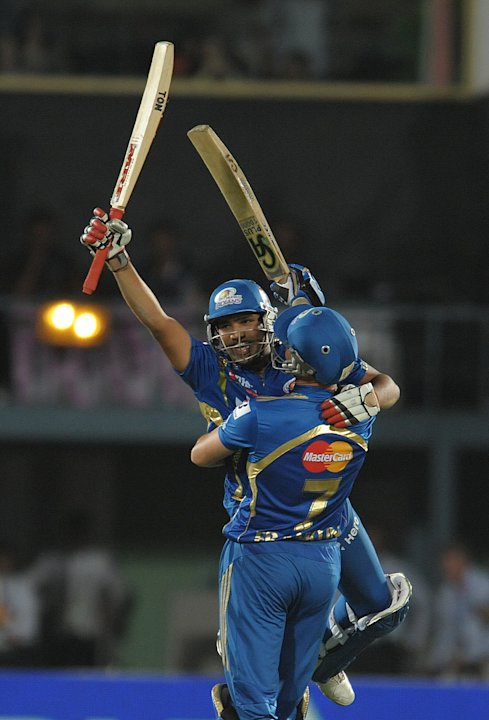 Mumbai Indians batsman Rohit Sharma celebrates with a teammate after winning shot on April 9, 2012 during the IPL Twenty20 cricket match against the Deccan Chargers at the Dr. Y.S. Rajasekhara Reddy C