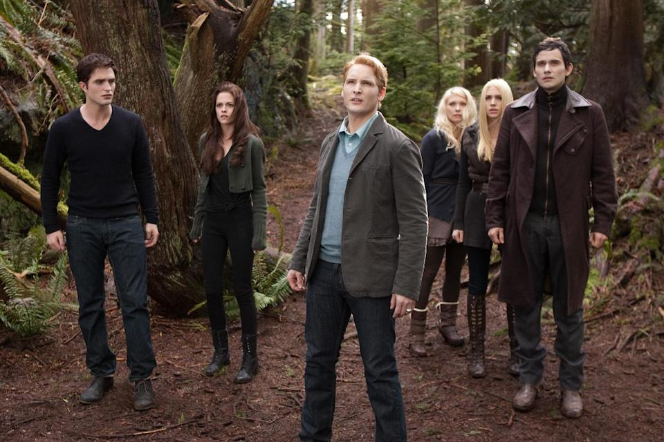 "This film image released by Summit Entertainment shows, from left, Robert Pattinson, Kristen Stewart, Peter Facinelli, MyAnna Buring, Casey LaBow and Christian Camargo in a scene from ""The Twilight Saga: Breaking Dawn Part 2."" (AP Photo/Summit Entertainment, Andrew Cooper)"