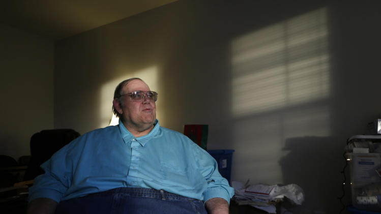 In this Dec. 21, 2013 photo, George Warren sits in his living room at Village Crossroads senior community in Nottingham, Md. Warren said he saw his modest earnings dry up so quickly that for a time he thought he might become homeless. (AP Photo/Patrick Semansky)