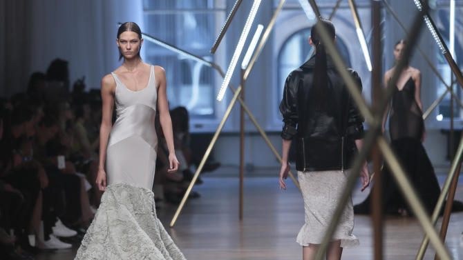 Fashion from the Jason Wu Spring Summer 2014 collection is modeled on Friday, Sept. 6, 2013 in New York. (AP Photo/Bebeto Matthews)
