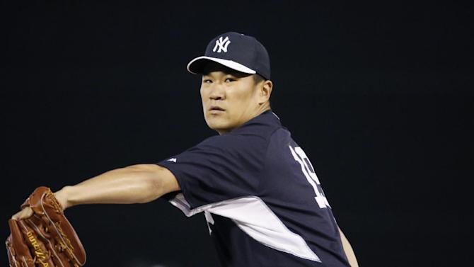 New York Yankees relief pitcher Masahiro Tanaka delivers a warmup pitch before relieving Hiroki Kuiroda in a spring exhibition baseball game against the Miami Marlins in Tampa, Fla., Friday, March 28, 2014. The Yankees defeated the Marlins 3-0