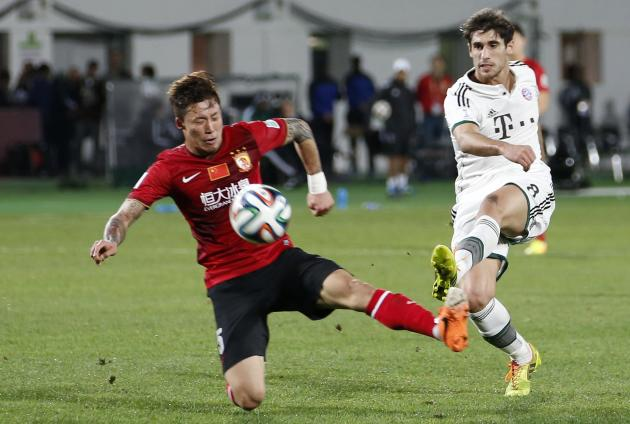 Guangzhou Evergrande's Zhang Linpeng fights for the ball with Bayern Munich's Javier Martinez during their FIFA Club World Cup soccer match at Agadir Stadium in Agadir