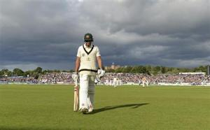 Australia's Khawaja leaves the field after being dismissed during the fourth Ashes cricket test match against England at the Riverside cricket ground in Chester-le-Street near Durham