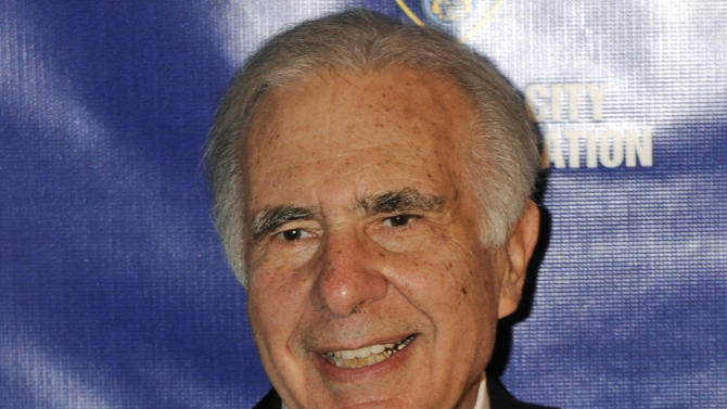 FILE - In this March 16, 2010 file photo, financier Carl Icahn poses for photos upon arriving for the 32nd annual New York City Police Foundation Gala in New York. Icahn has told Apple CEO Tim Cook that the iPhone and iPad maker should launch a $150 billion stock buyback immediately and disclosed that he now owns 4.7 million shares in the company. In a letter to Cook posted online on Thursday, Oct. 24, 2013, Icahn said he has increased his stake in Apple by 22 percent from 3.9 million at the end of September. At Apple's current stock price, that's worth about $2.5 billion and amounts to less than a 1 percent stake in the company. He plans to increase his stake. Icahn wants Apple to launch the buyback at its current stock price, which closed at close to $525 on Wednesday when the letter was sent. He stressed that he does not plan to tender any of his shares in the buyback he is proposing. (AP Photo/Henny Ray Abrams, File)