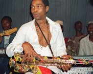 Fela Kuti plays in Lagos in 1988. The spirit of Fela Kuti haunts his old house -- the musician&#39;s colourful clothes in the bedroom, his shoes on a rack -- but the marijuana smoke, his many wives and his beguiling sax playing are long gone