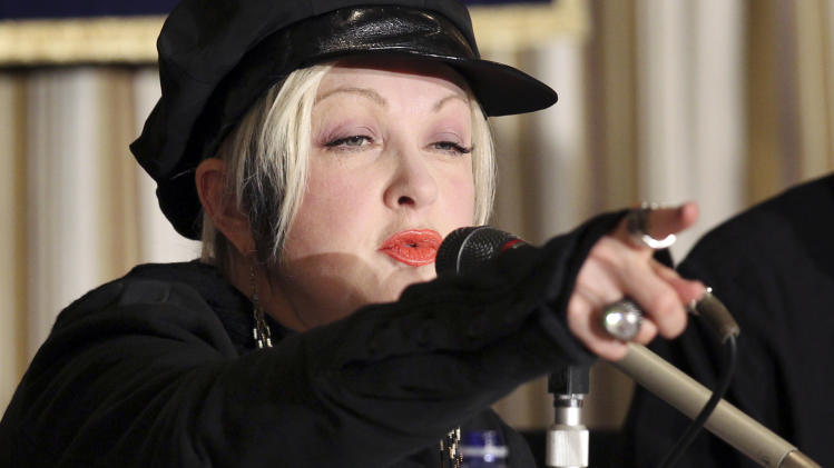 FILE - This March 12, 2012 file photo shows Cyndi Lauper speaking during a news conference at the Foreign Correspondents' Club of Japan in Tokyo. Lauper has a memoir coming out this fall, Atria Books announced Monday, April 9, 2012. (AP Photo/Junji Kurokawa, file)