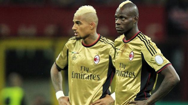 AC Milan's Kevin-Prince Boateng (L) and Mario Balotelli look on as referee Gianluca Rocchi suspends the match due to racist chants during their Italian Serie A soccer match against AS Roma at the San Siro stadium in Milan May 12, 2013 (Reuters)