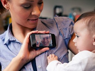mother and baby chatting on a video call