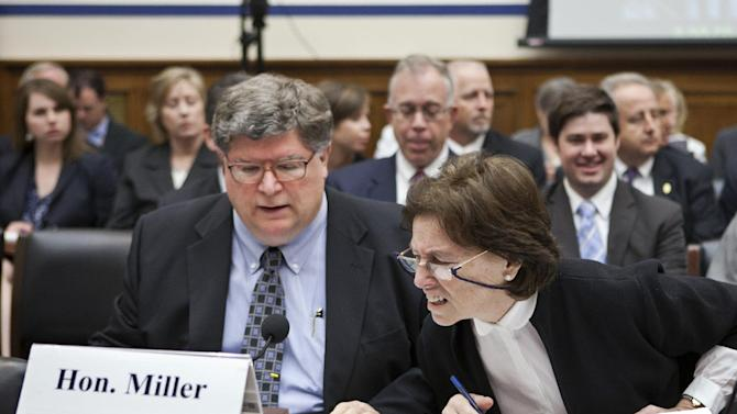 GSA Inspector General Brian Miller, left, and GSA Deputy Administrator Susan Brita, confer on Capitol Hill in Washington, Tuesday, April 17, 2012, while testifying before the House Economic Development, Public Buildings and Emergency Management subcommittee hearing of an excessive conference at a Las Vegas resort by General Services Administration officials in 2010. (AP Photo/J. Scott Applewhite)
