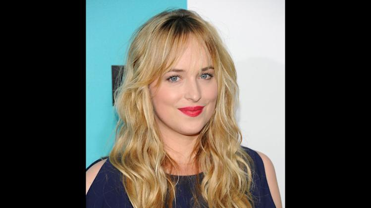 "FILE - Dakota Johnson attends the FOX network upfront presentation party at Wollman Rink, in New York in a May 14, 2012 file photo. Focus Features and Universal Pictures announced Monday, Sept. 2, 2013 that Dakota Johnson will play Anastasia Steele in the big-screen adaptation of E L James' ""Fifty Shades of Grey."" Johnson is the daughter of actors Don Johnson and Melanie Griffith. (AP Photo/Evan Agostini, File)"