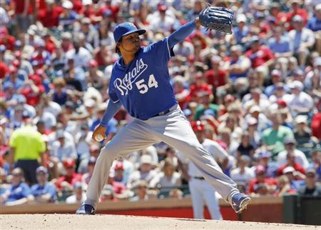 Kansas City Royals pitcher Santana throws against the Texas Rangers in the second inning of their MLB American League baseball game in Arlington, Texas