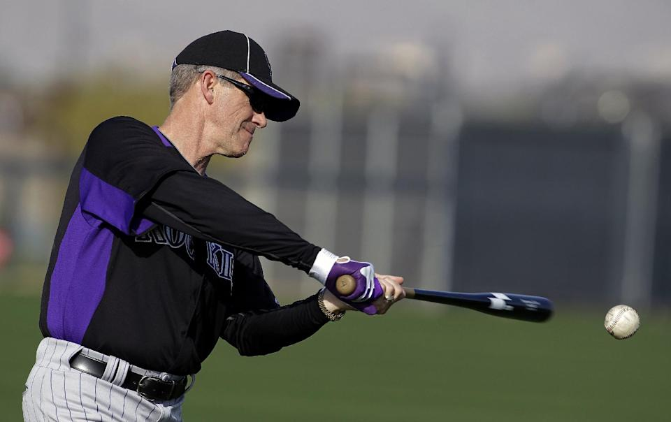 Colorado Rockies manager Jim Tracy hits during a spring training baseball workout, Monday, Feb. 20, 2012, in Scottsdale, Ariz. (AP Photo/Darron Cummings)
