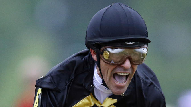 Jockey Gary Stevens celebrates after riding Oxbow to win the 138th Preakness Stakes horse race at Pimlico Race Course, Saturday, May 18, 2013, in Baltimore. (AP Photo/Patrick Semansky)
