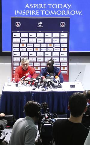 Paris Saint Germain's new coach Carlo Ancelotti, left, of Italy, and PSG defender Mamadou Sakho  attend a  press conference in Doha, Qatar, on,Tuesday Jan. 3, 2012 . (AP Photo/Osama Faisal)