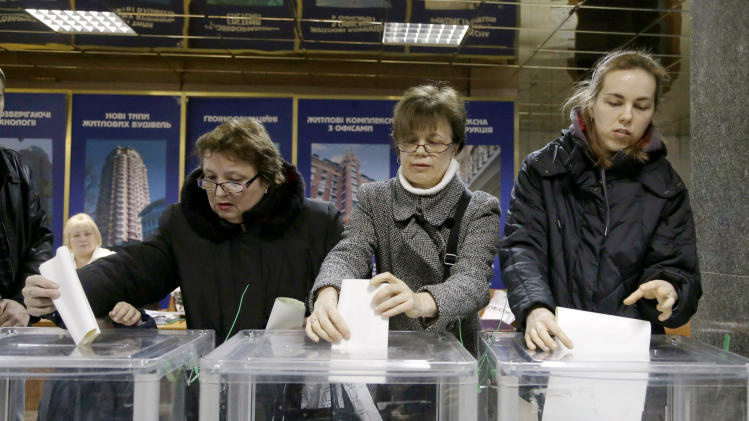 Ukraine votes with opposition leader in jail