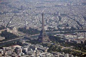 An aerial view shows the Eiffel Tower and the Seine River in Paris